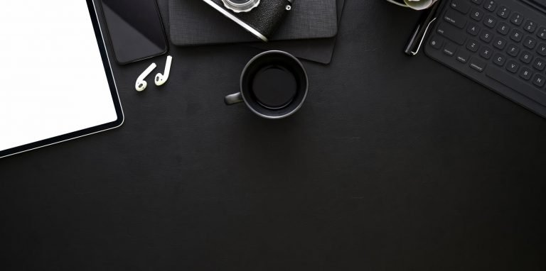 black ceramic cup on a black surface